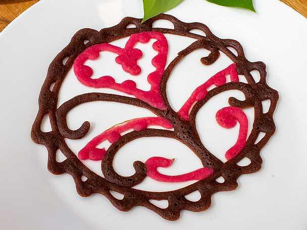Brodyrpannkaka med hallon och choklad